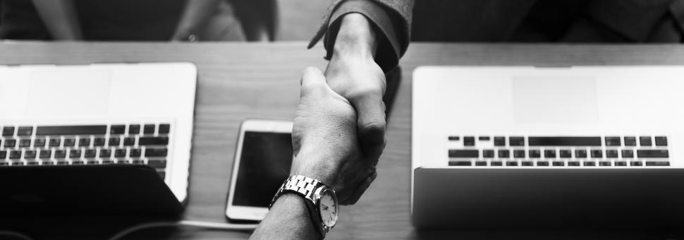 two-business-people-shake-hands--black-and-white